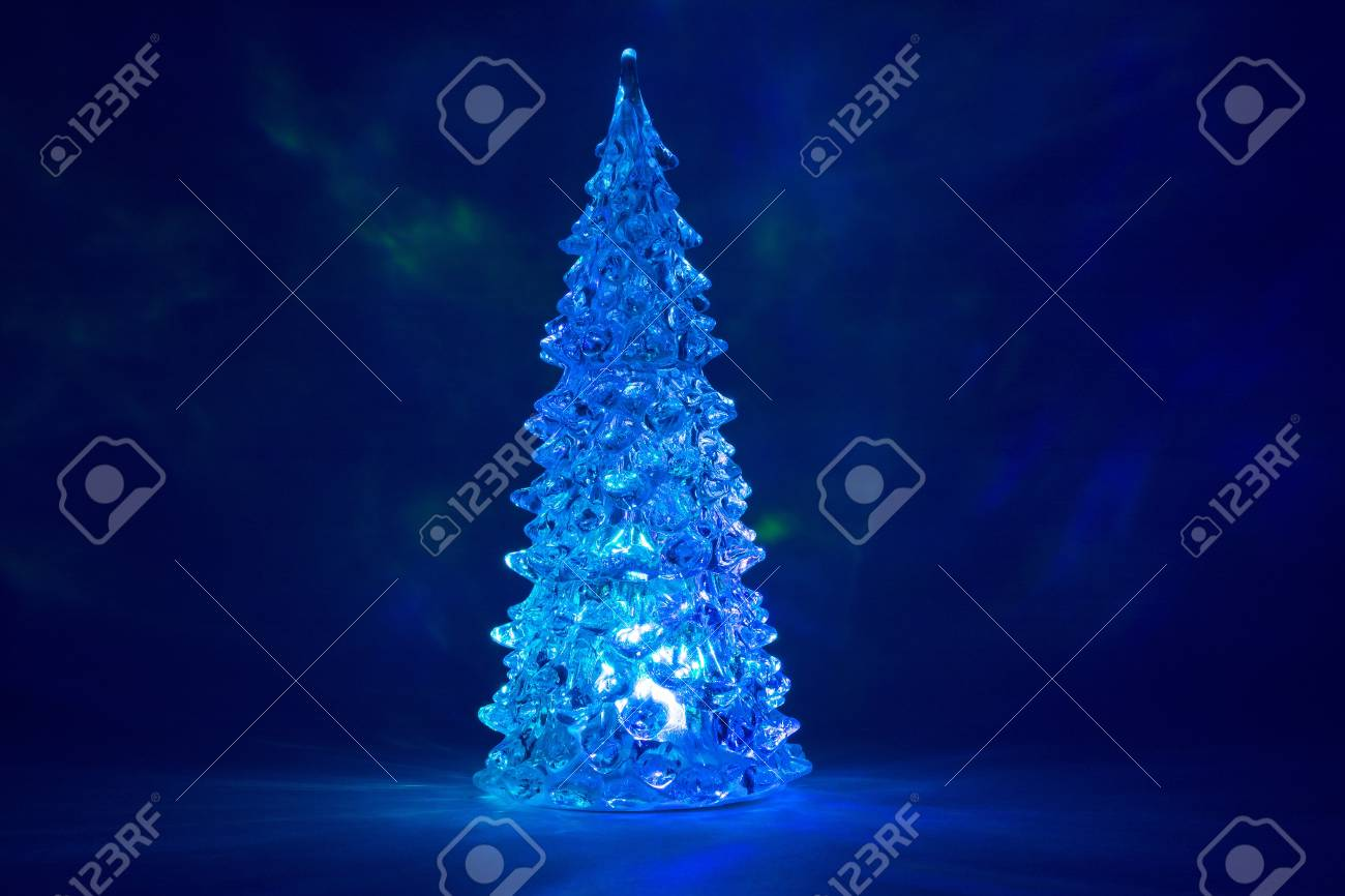 christmas tree toy with snow shining with a beautiful shadow northern lights background and highlights in