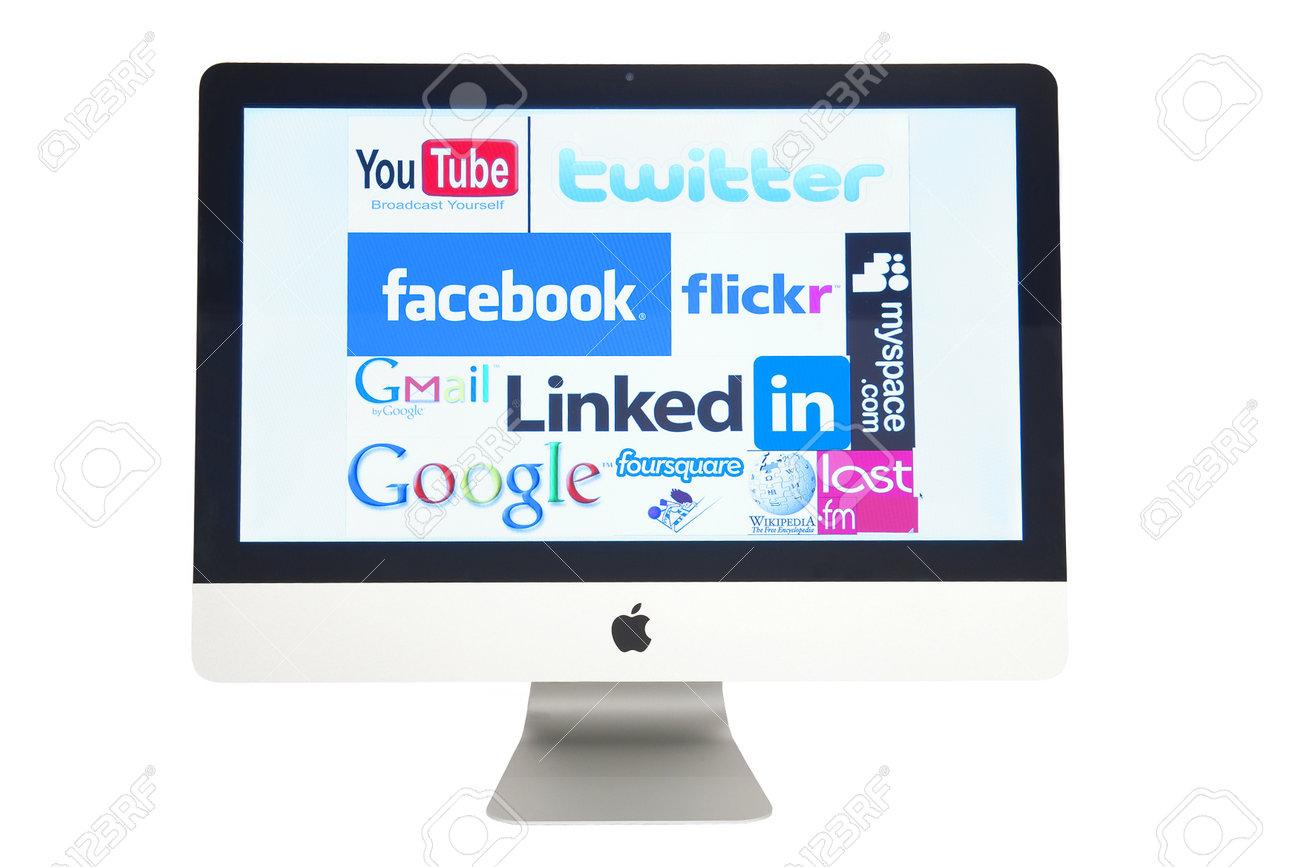 Computer Apple iMac screen with social network logos isolated on white studio shot, September 28, 2011, Poland Stock Photo - 14816921