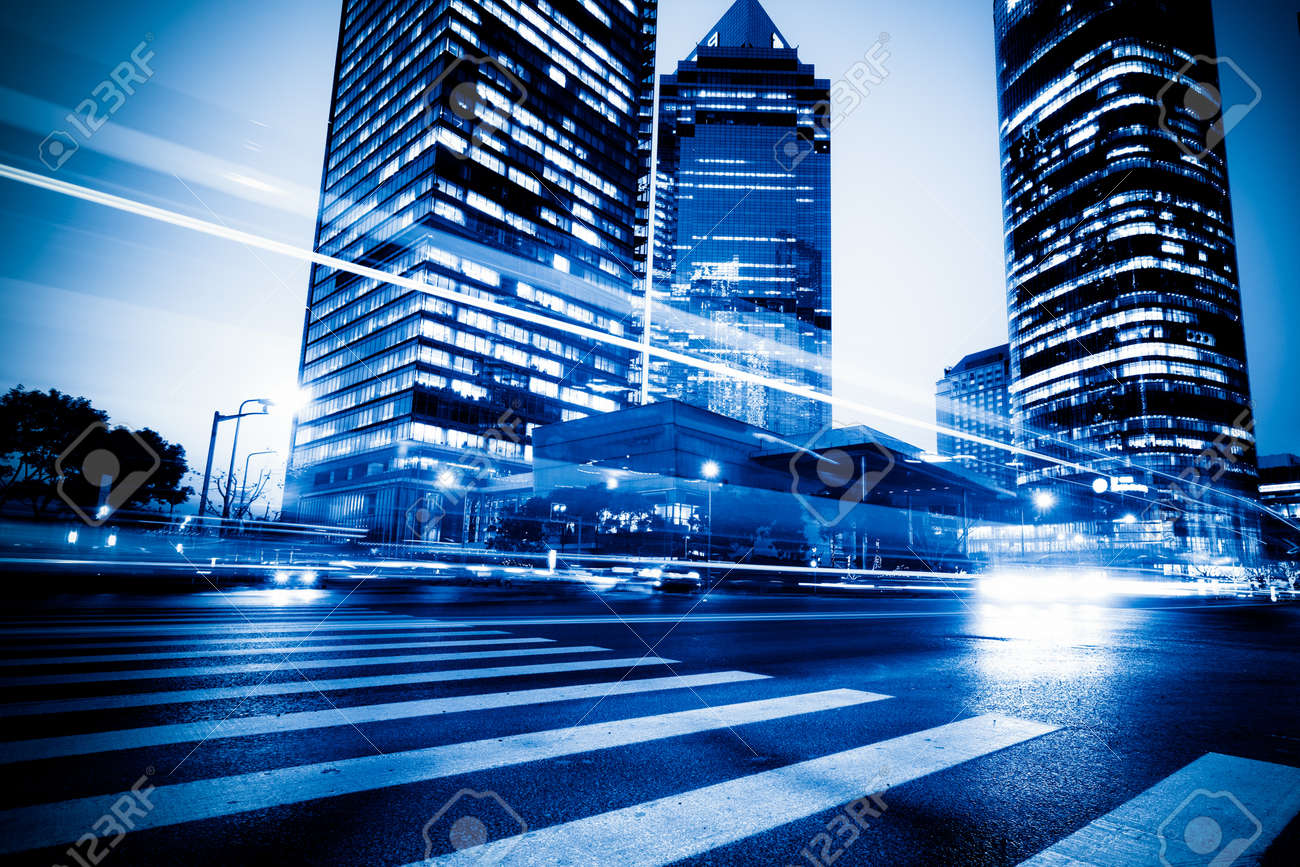 the light trails on the modern building background in shanghai china. - 10619862