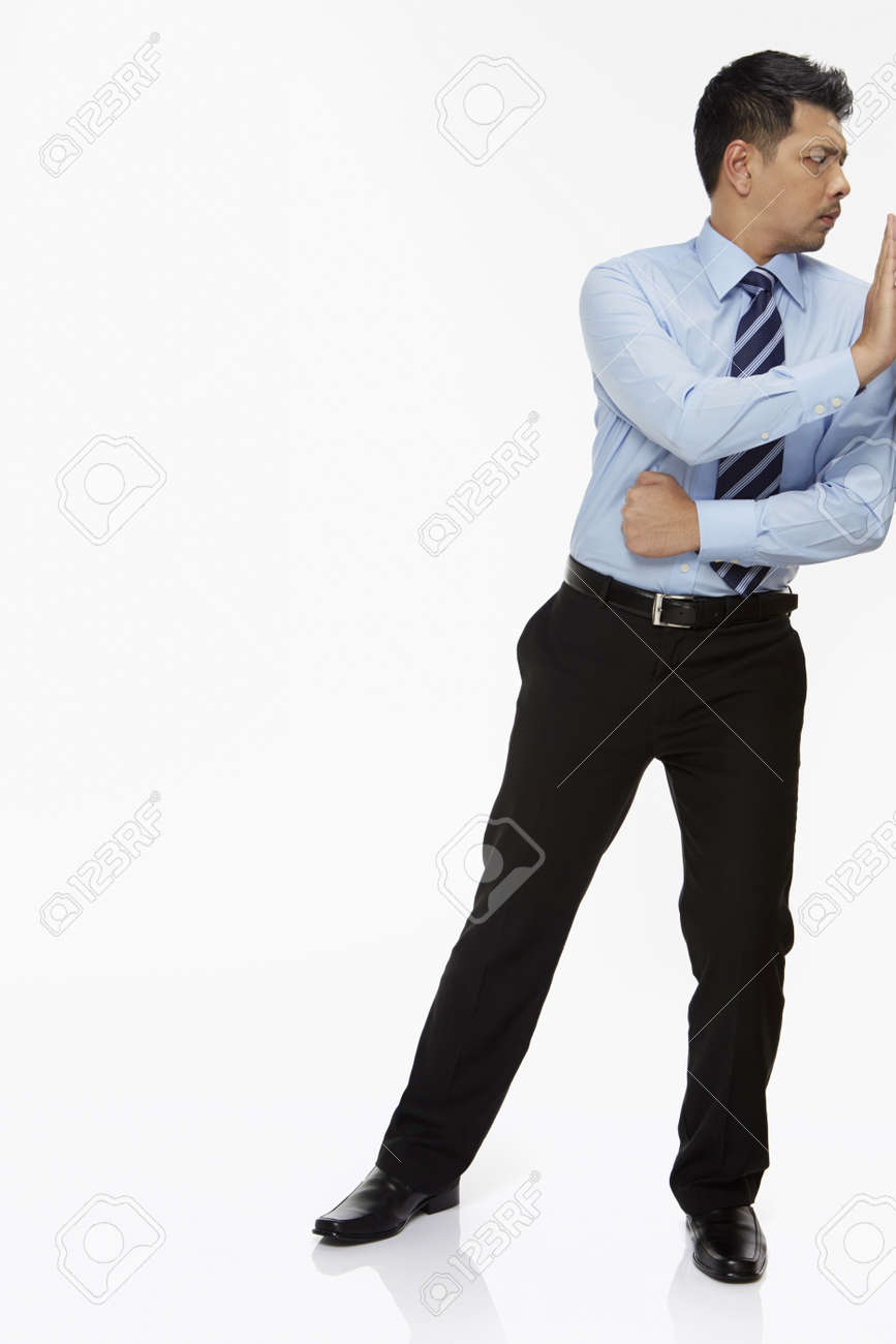 Businessman pushing a wall - 22839818
