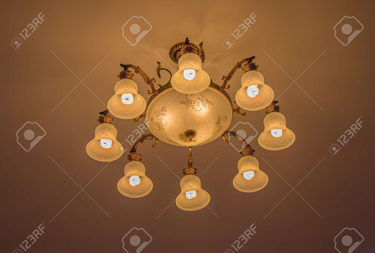 Ceiling lamps for the interior of modern buildings on a dim background