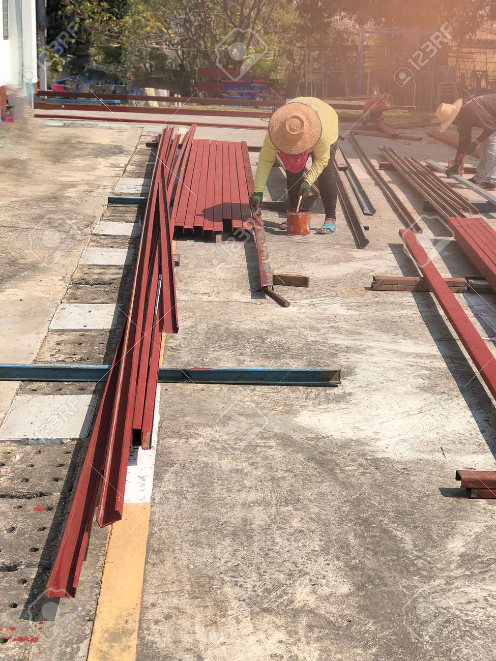 Worker Paint Steel To Prevent Rust Amid Sun Stock Photo Picture And