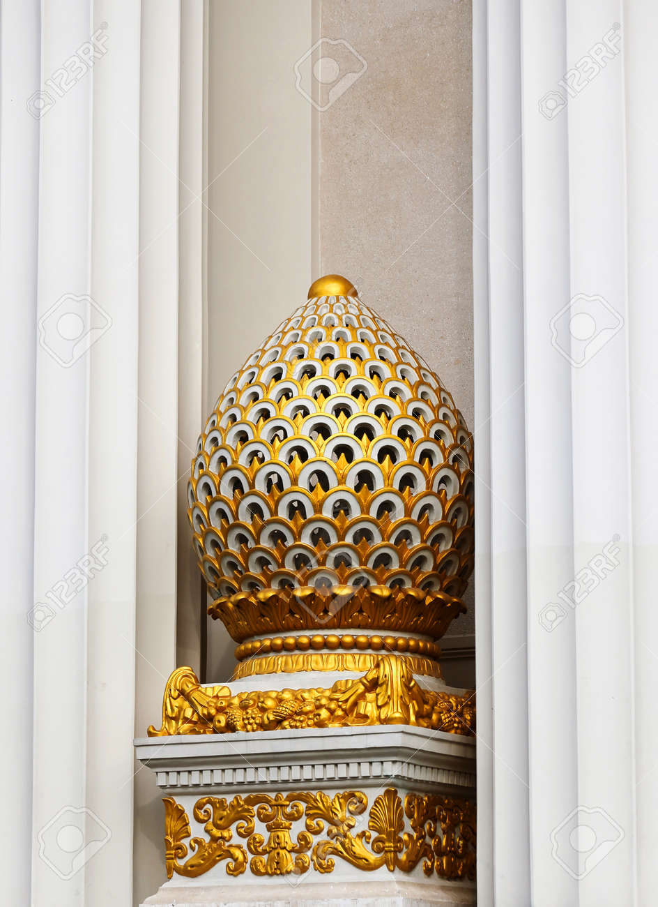 an architectural element of decoration of a historic building made of marble covered with gold - 156408654