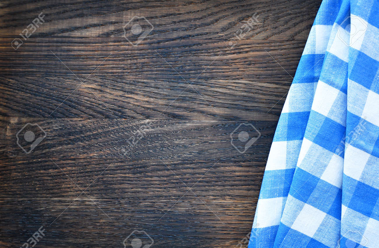 Napkin on wooden background. Top view - 146858564