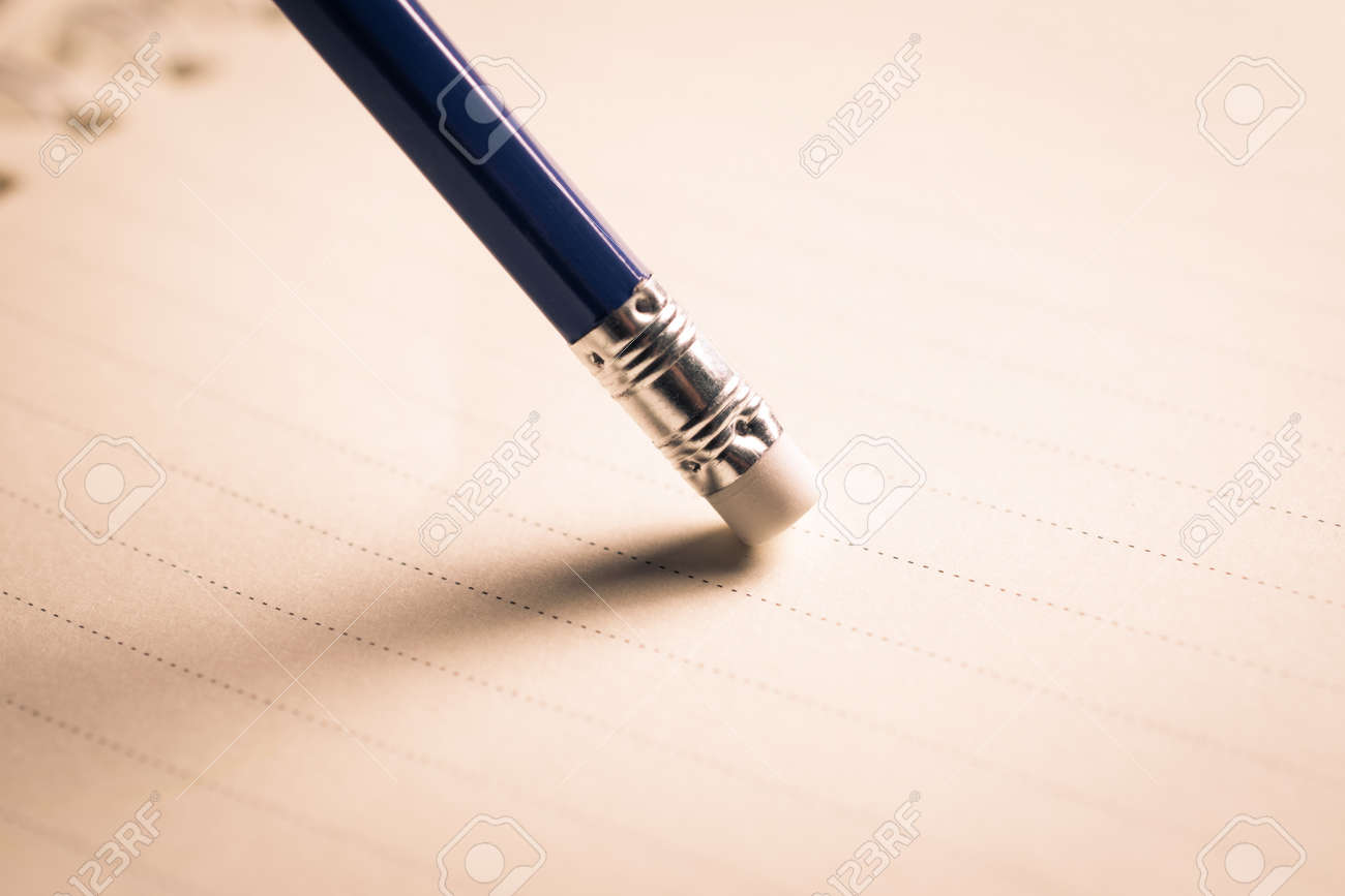 pencil eraser removing a written mistake on a piece of paper stock photo picture and royalty free image image 79321463
