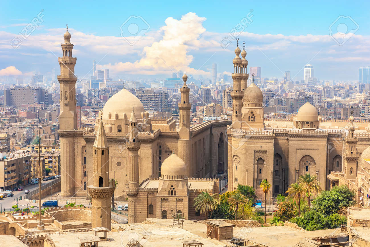 The Mosque-Madrassa of Sultan Hassan and Cairo buildings in the background, Egypt. - 136166380