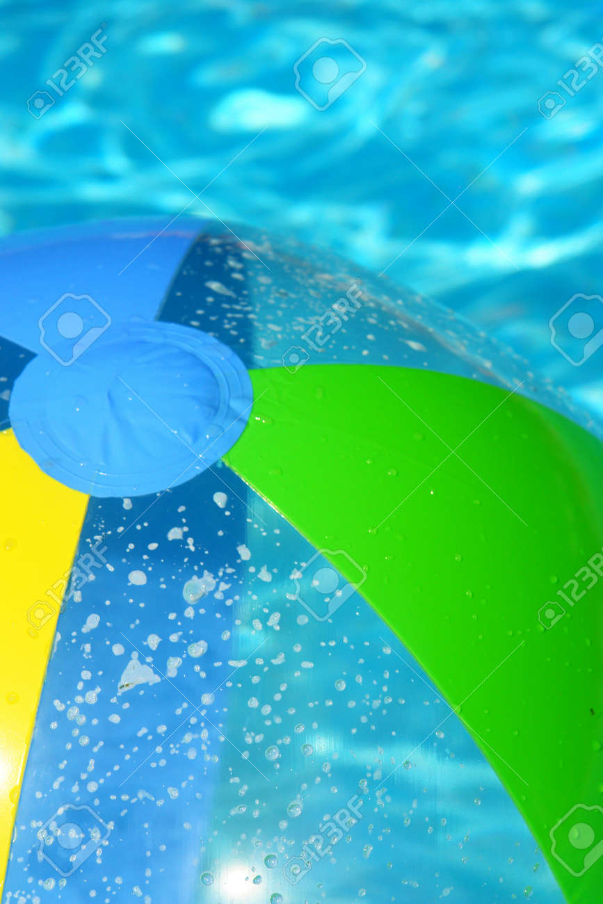 Pool Water With Beach Ball beach ball in the pool fresh water stock photo, picture and