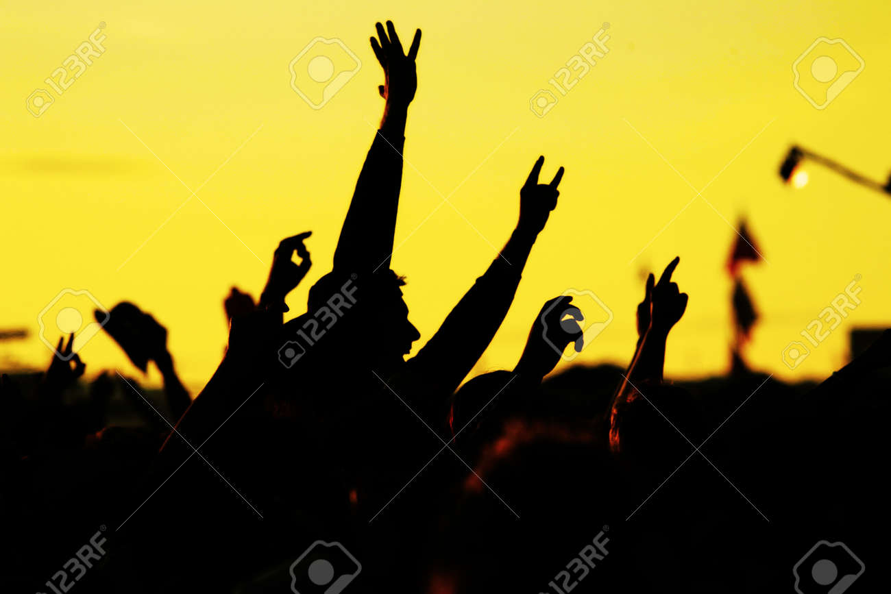 people celebrating on an open air shillouettes Stock Photo - 8952437