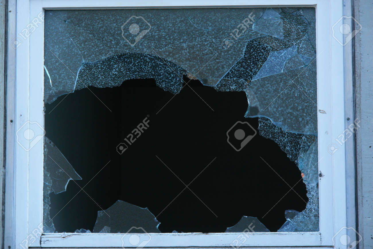Broken Window with very sharp glass fragments Stock Photo - 11092898