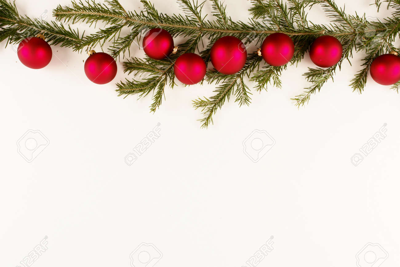 Border Of Red Christmas Garland With Baubles And Ribbons On White Stock Photo