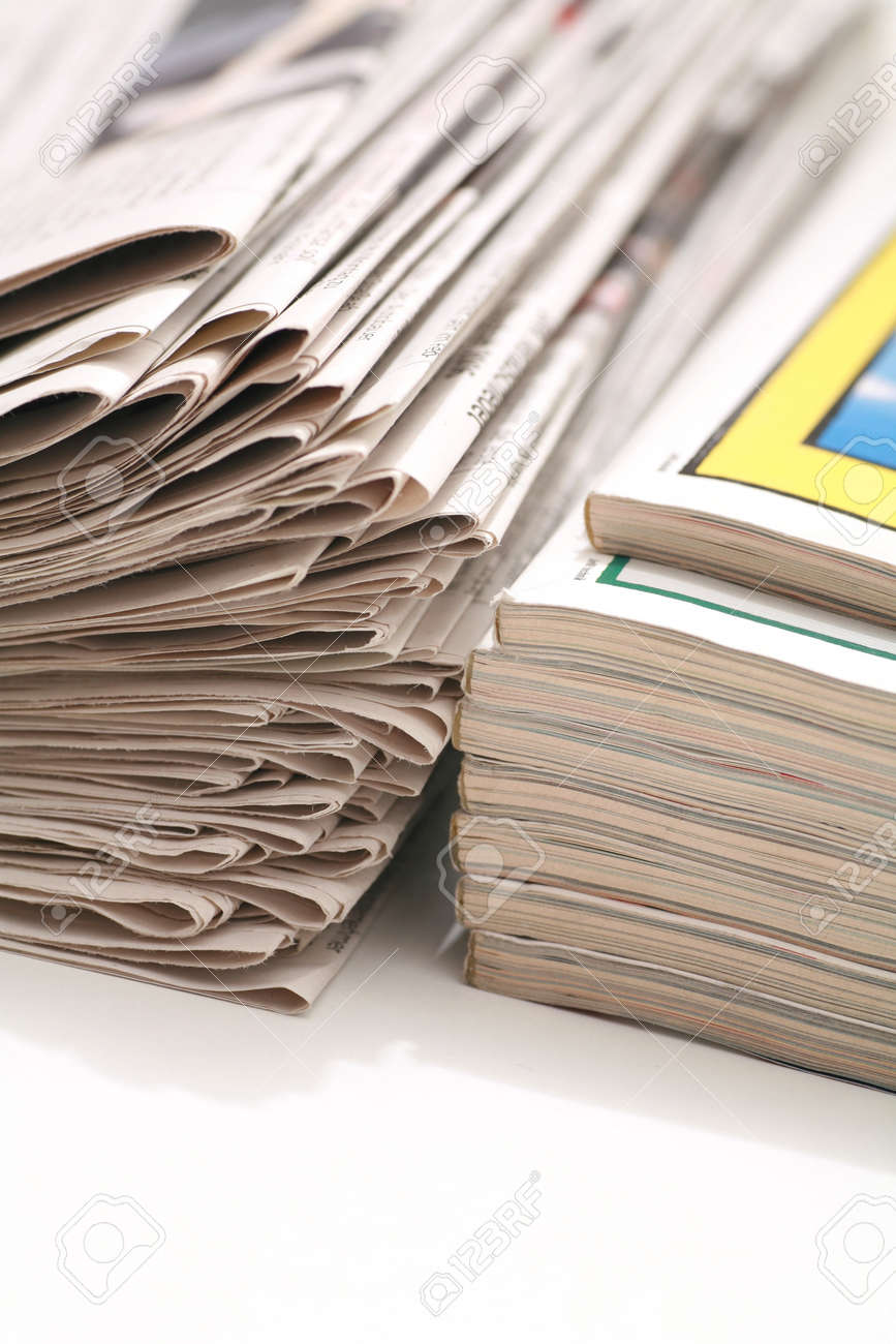 close-up of newspapers magazine on a white backgroung Stock Photo - 16257495