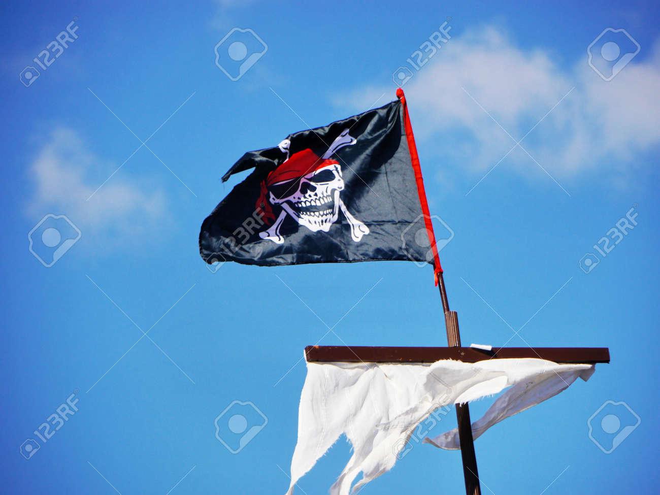 Jolly Roger skull and crossbones black pirate flag Stock Photo - 17551163
