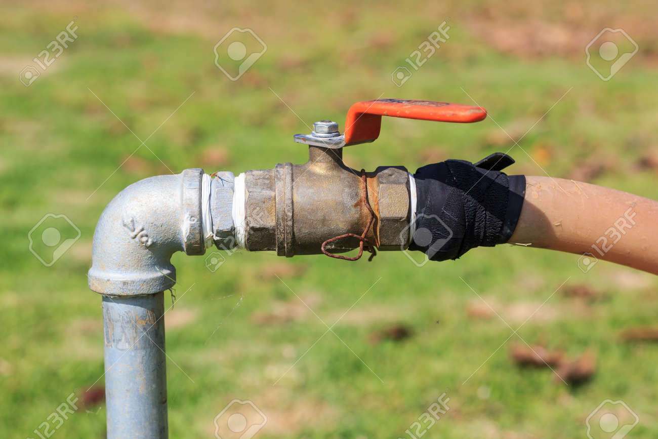 Old Faucet. Old Rusty Water Tap In The Yard. Stock Photo, Picture ...