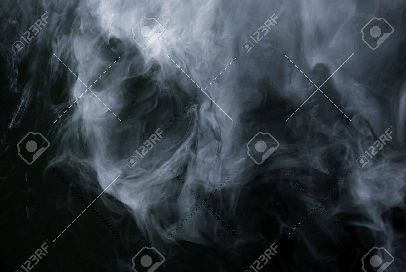 Appearance of cigarette smoke forming the shape of a skull.  Good for stop smoking ad, campaign, pamphlet, brochure or advertisement. Dry ice carbon dioxide gasses forming an image of a scary skull. Stock Photo - 2451170
