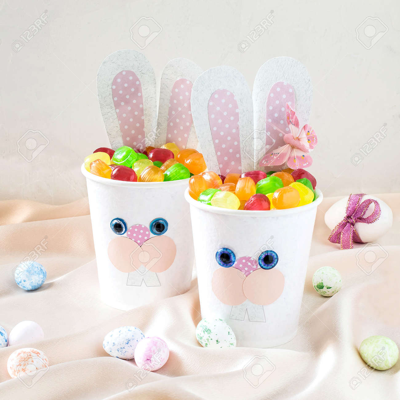 Paper cups in the form of funny easter bunny with candy homemade paper cups in the form of funny easter bunny with candy homemade applique on paper negle Images