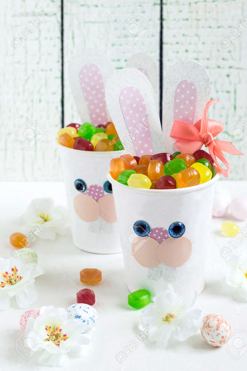 Paper cups in the form of funny easter bunny with candy homemade paper cups in the form of funny easter bunny with candy homemade applique on paper negle Image collections