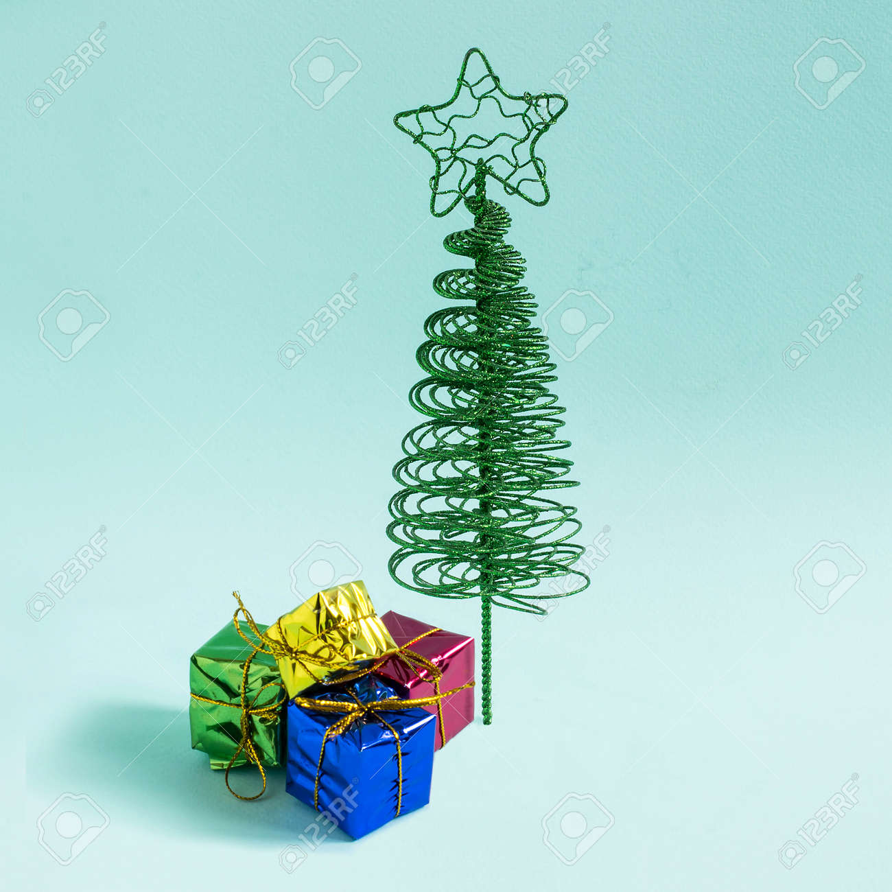 Small Elegant Christmas Tree Made Of Wire And Gifts On Gradient Stock Photo Picture And Royalty Free Image Image 103028254
