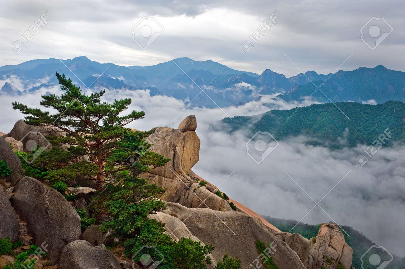 Hanging stone at the Ulsanbawi Rock against the fog seorak mountains at the Seoraksan National Park, South korea Stock Photo - 9675232