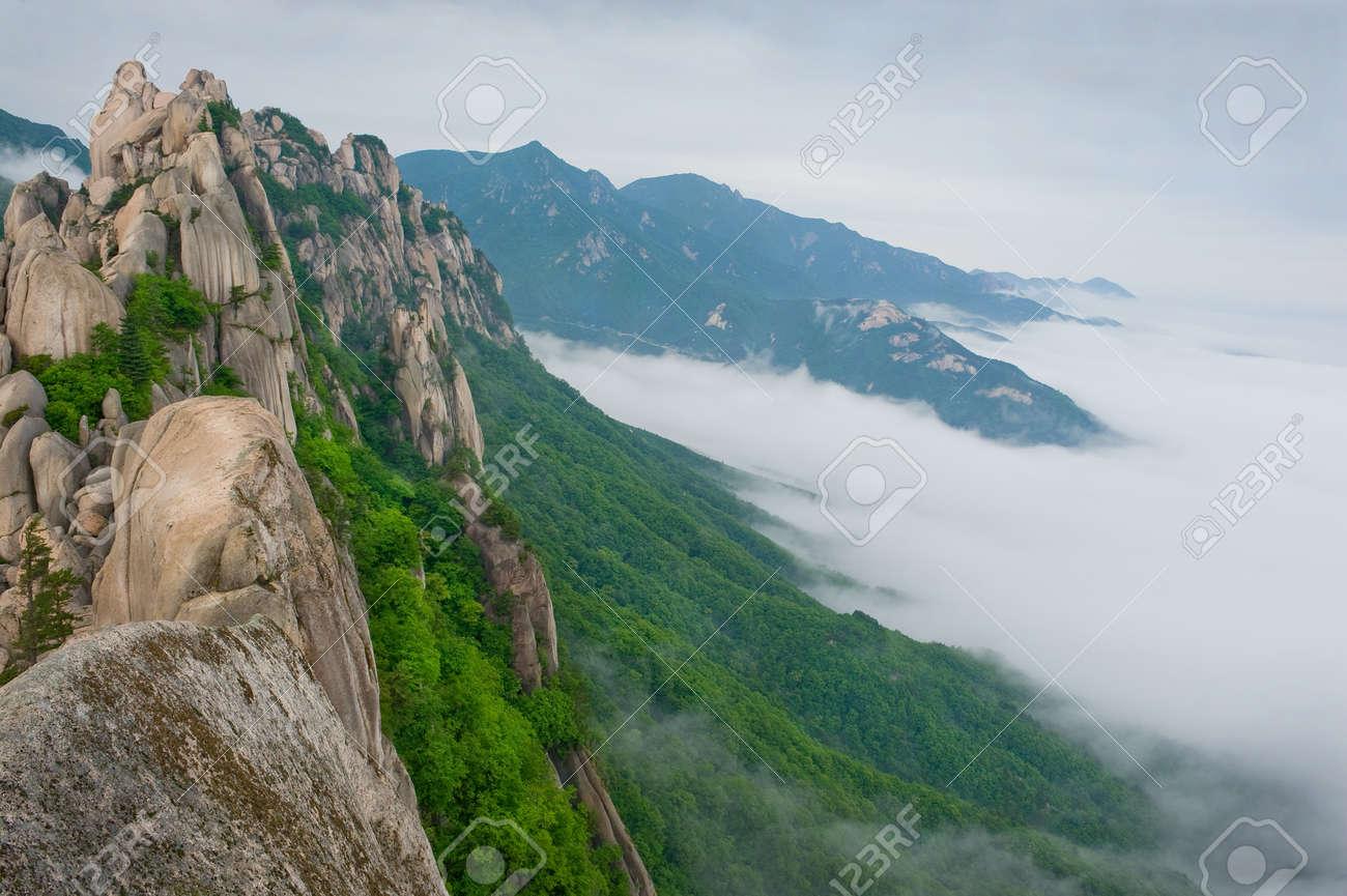 Famous Ulsanbawi Rock against the fog seorak mountains at the Seorak-san National Park, South korea Stock Photo - 10369336