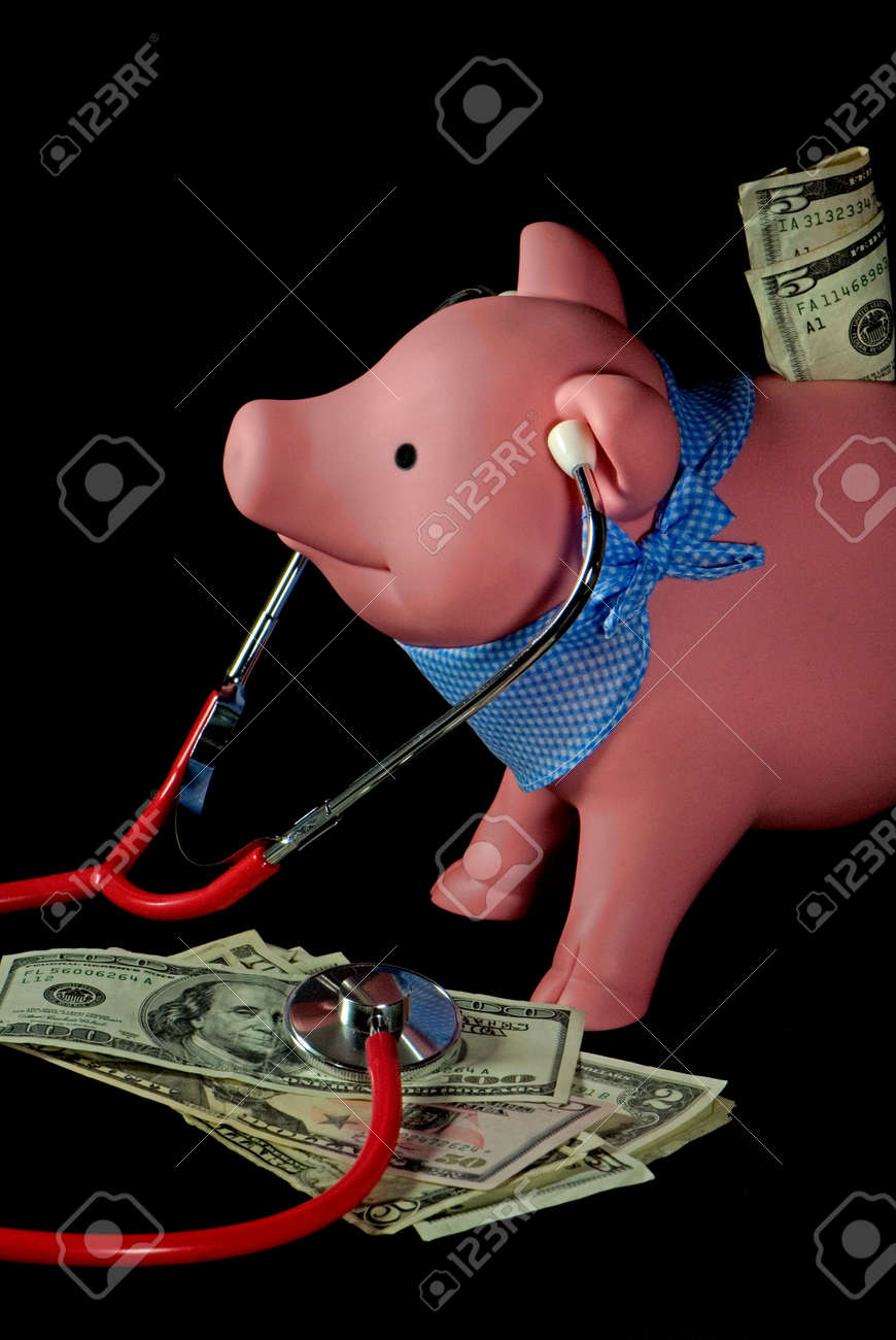 Piggy bank with stethscope on a pile of money. Stock Photo - 4815837
