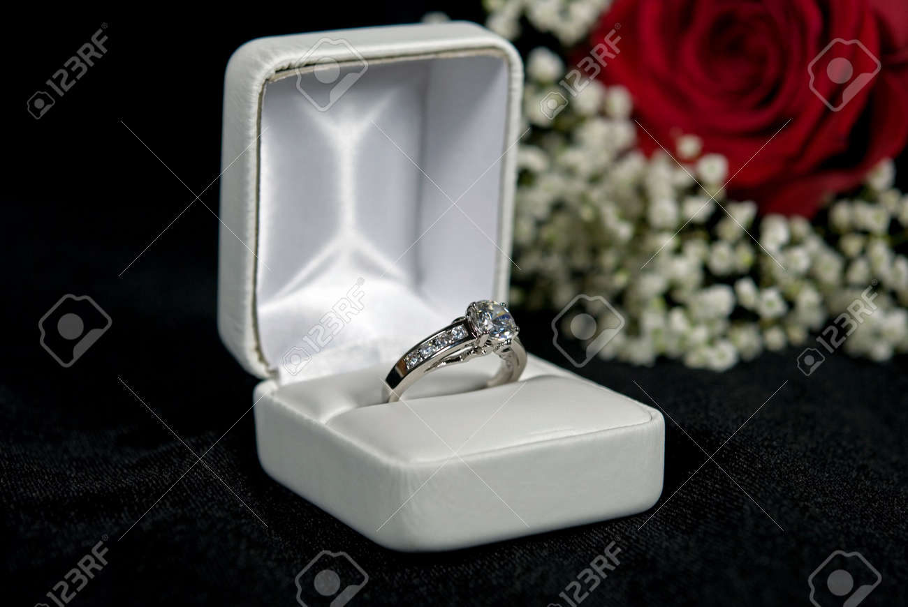 Diamond Engagement Ring In Box With Rose. Stock Photo, Picture And ...