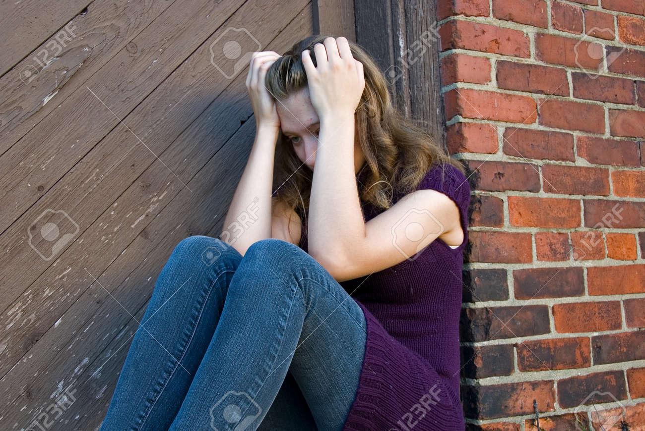 lonely teenage girl in old doorway Stock Photo - 10346901