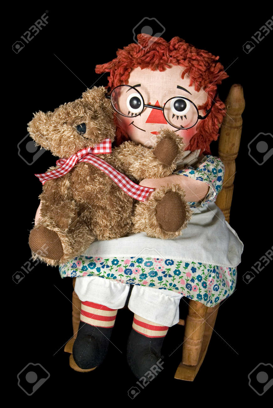 Rag doll and teddy bear in rocking chair. Stock Photo - 10818227