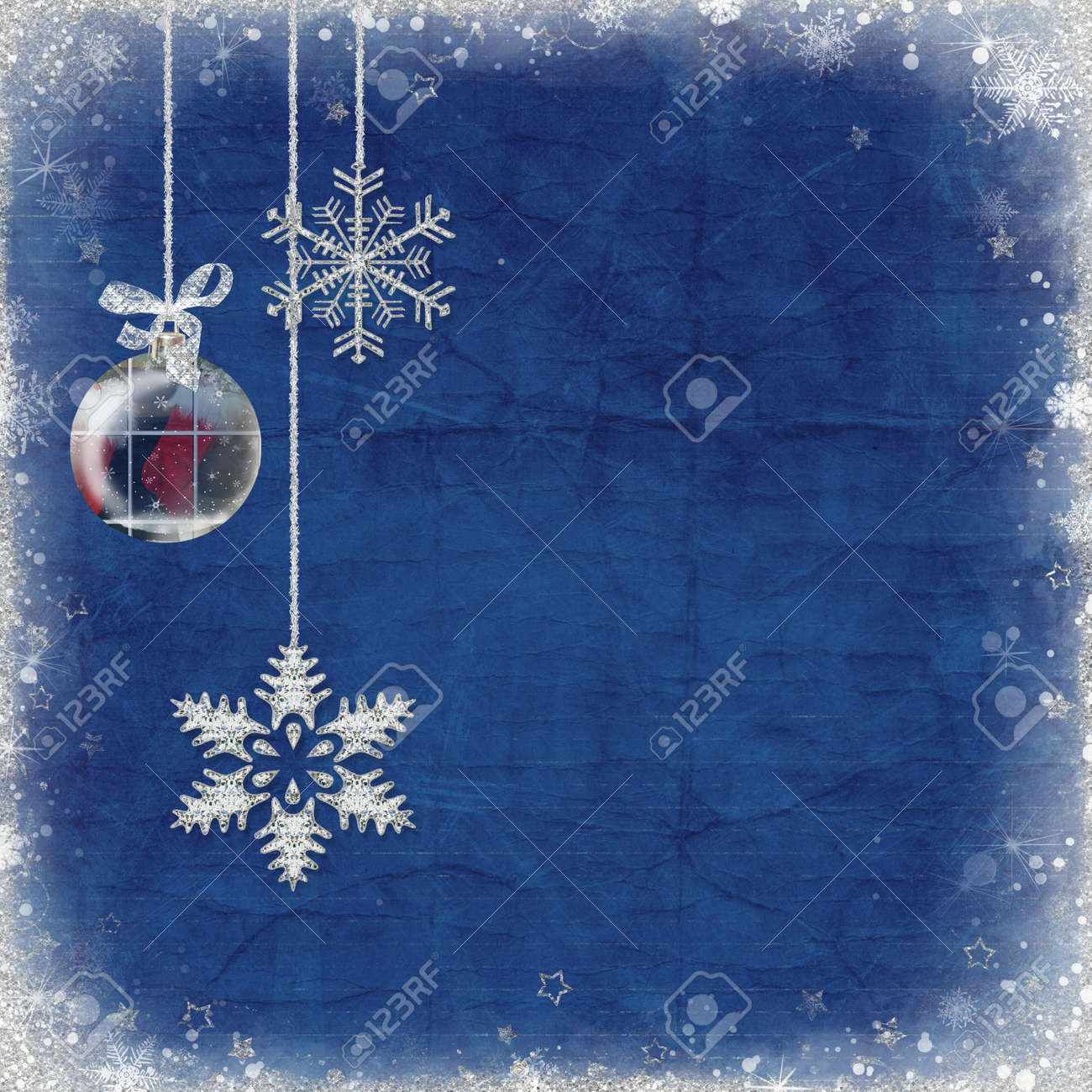 Snowflakes and ornament hanging from tinsel. Stock Photo - 11566098