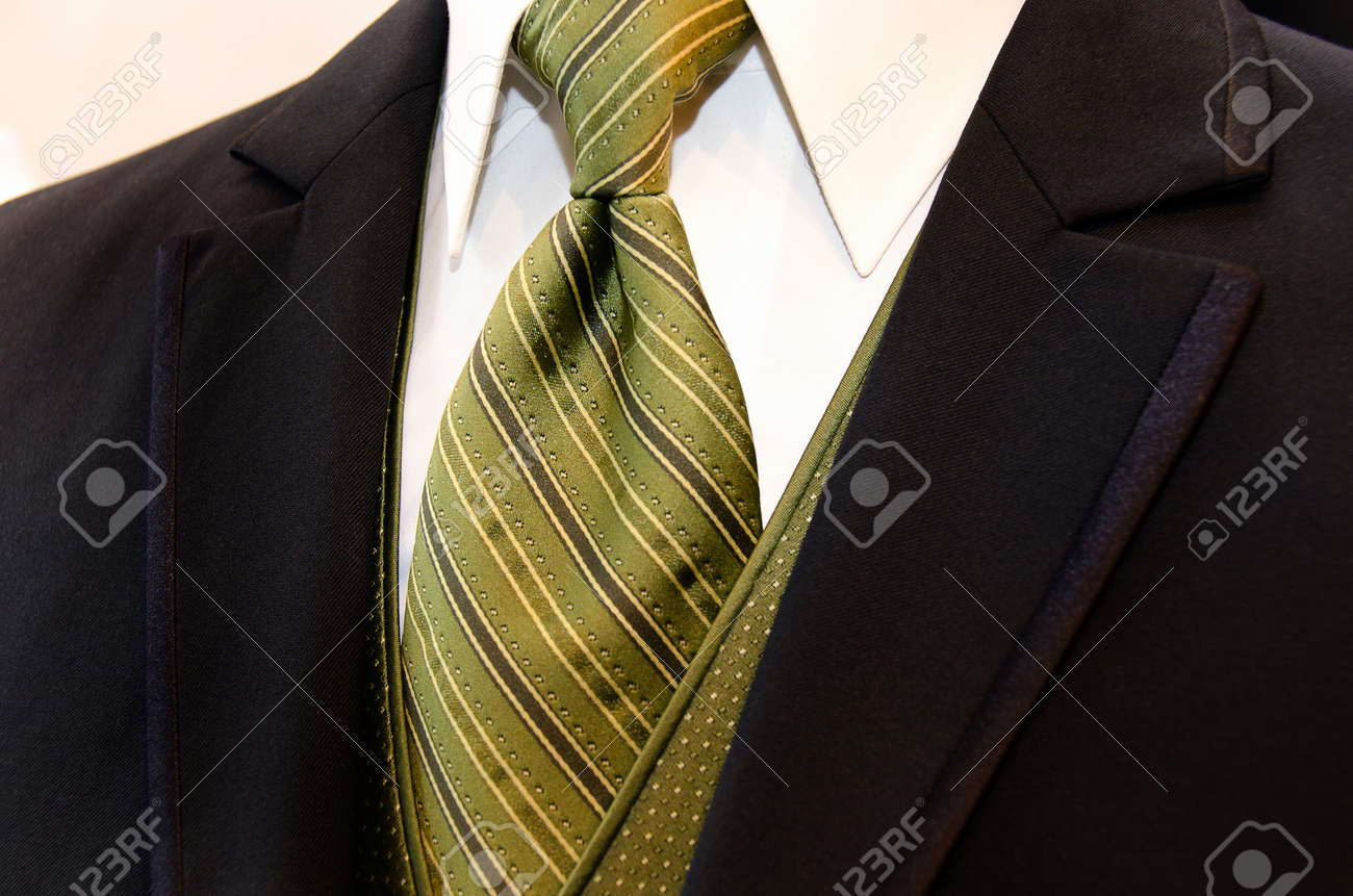 Rich brown tuxedo with striped silk tie Stock Photo - 13091336
