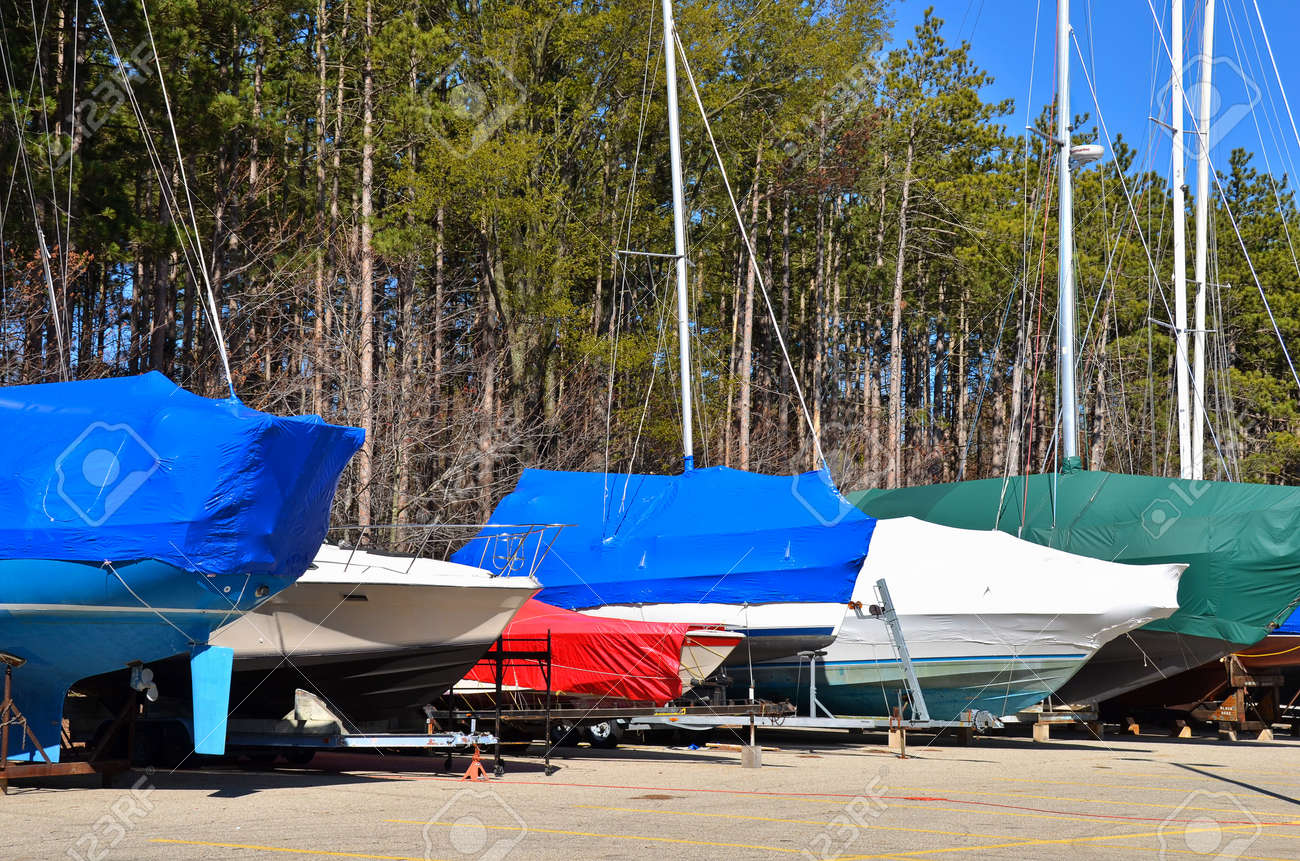 colorful covers on sail and power boats Stock Photo - 13416512