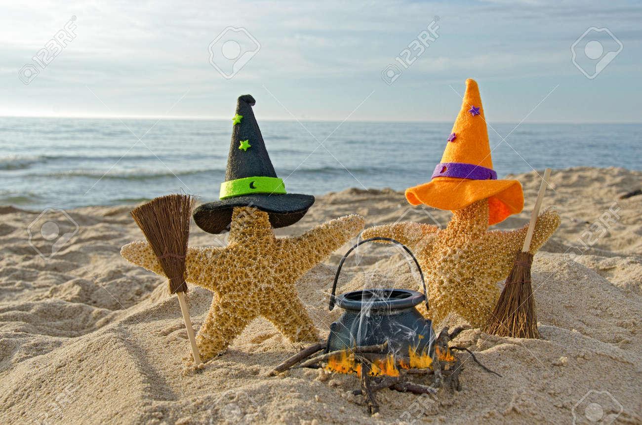 Halloween starfish on the beach with brooms Stock Photo - 22256946