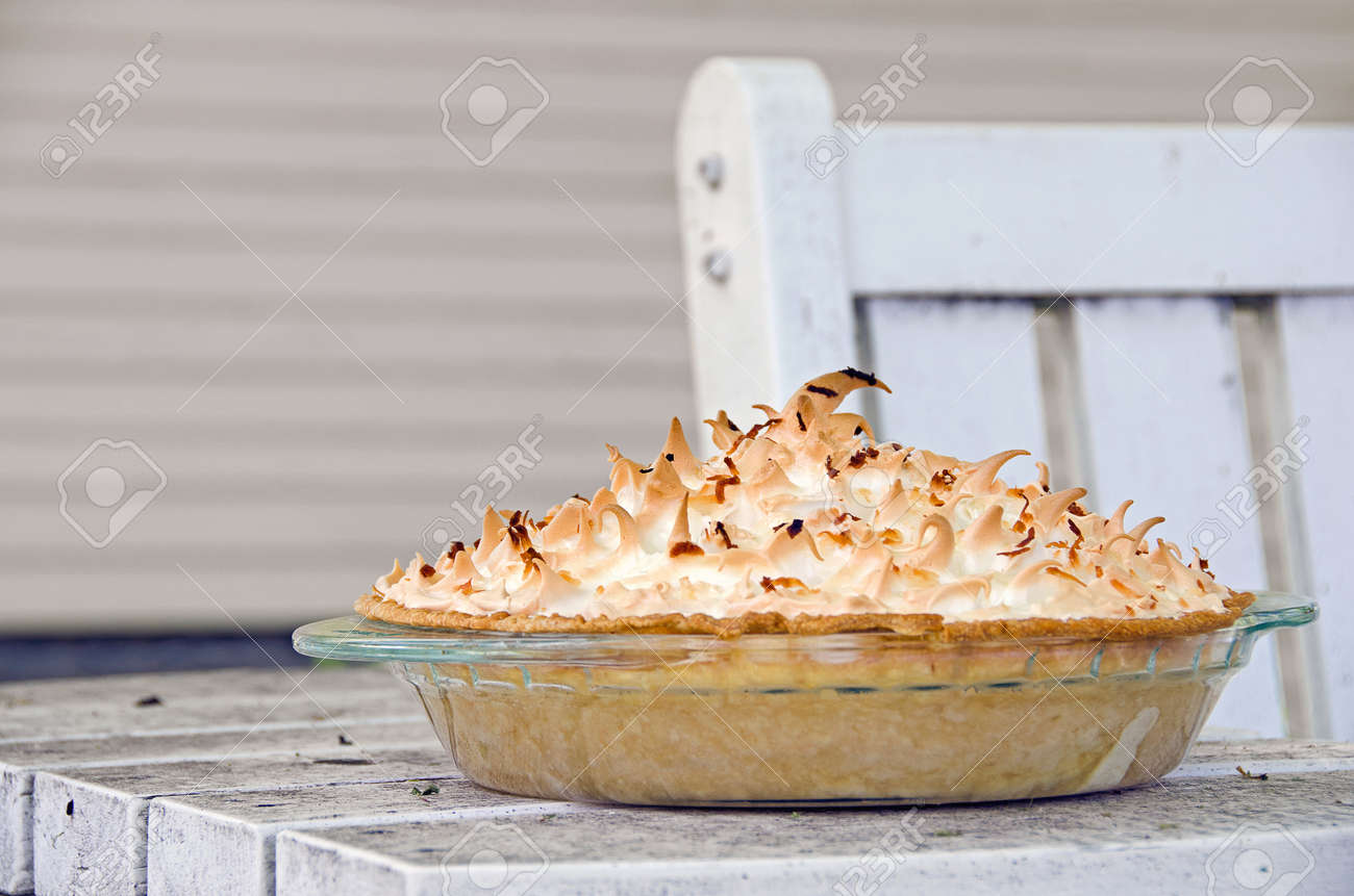 coconut cream pie on outdoor patio table Stock Photo - 28924134