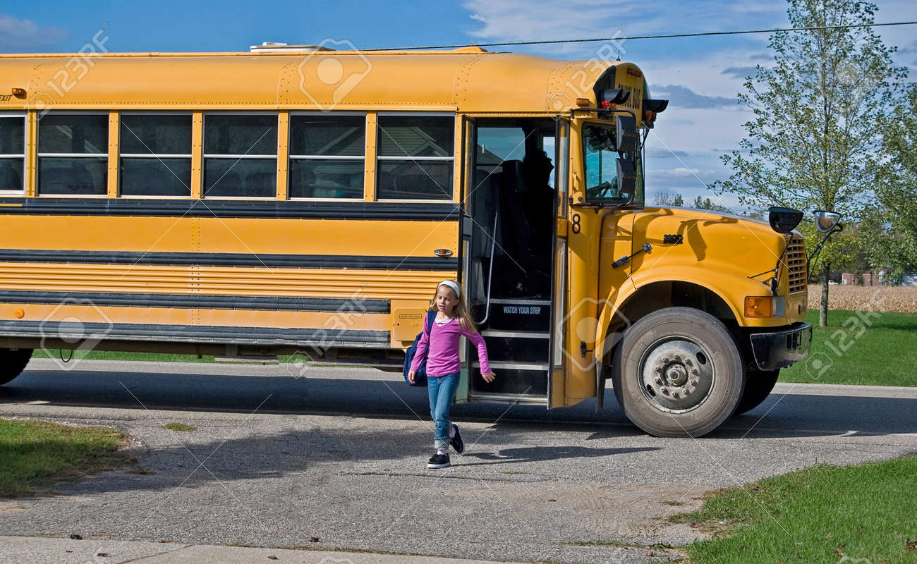 girl getting off a school bus Stock Photo - 30085522