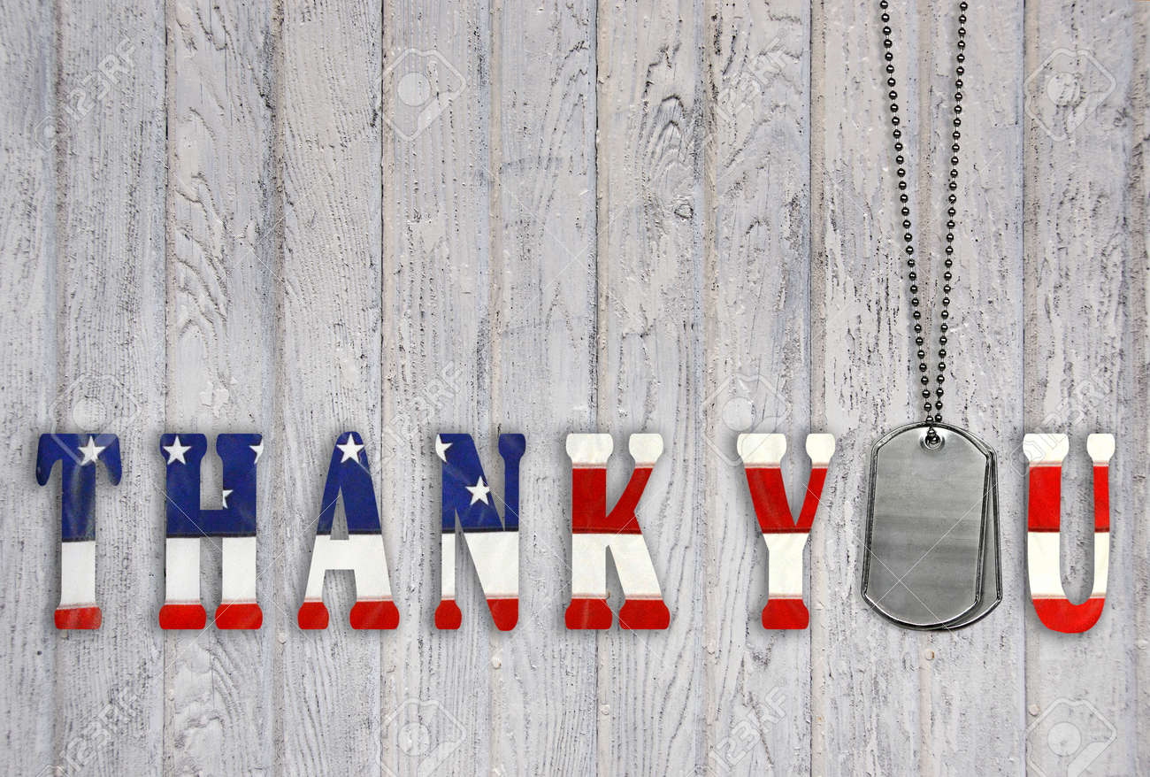 military dog tags with patriotic flag thank  you on wood Stock Photo - 33379312