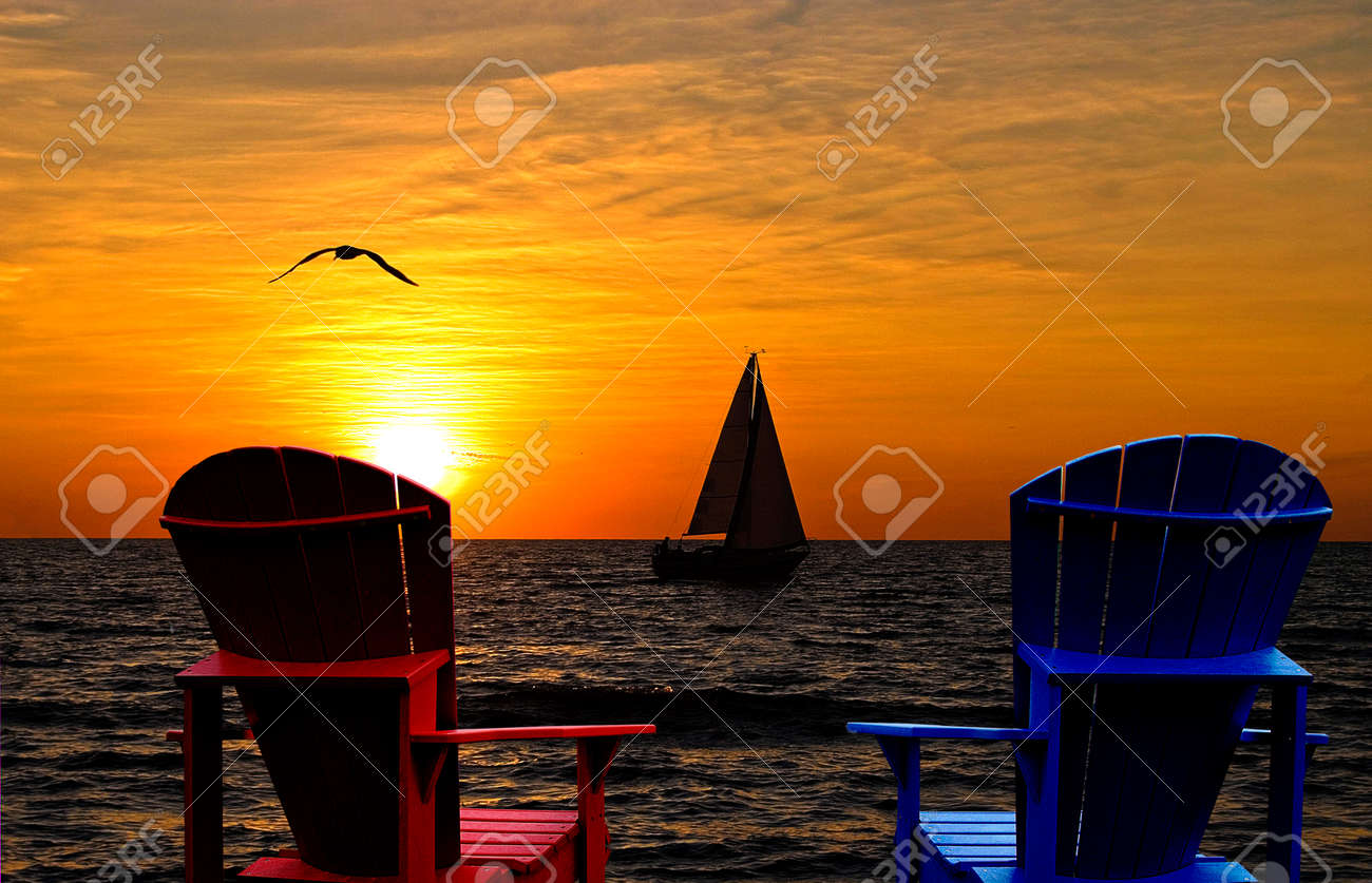 Brilliant Adirondack Chairs With Sailboat On Lake Michigan At Sunset Bralicious Painted Fabric Chair Ideas Braliciousco