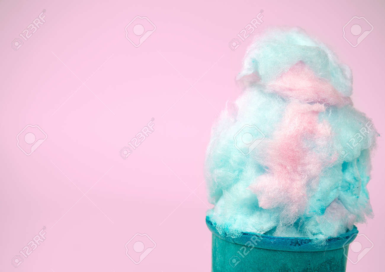 16f4d4ac6105d cotton candy in cone isolated on pastel pink background