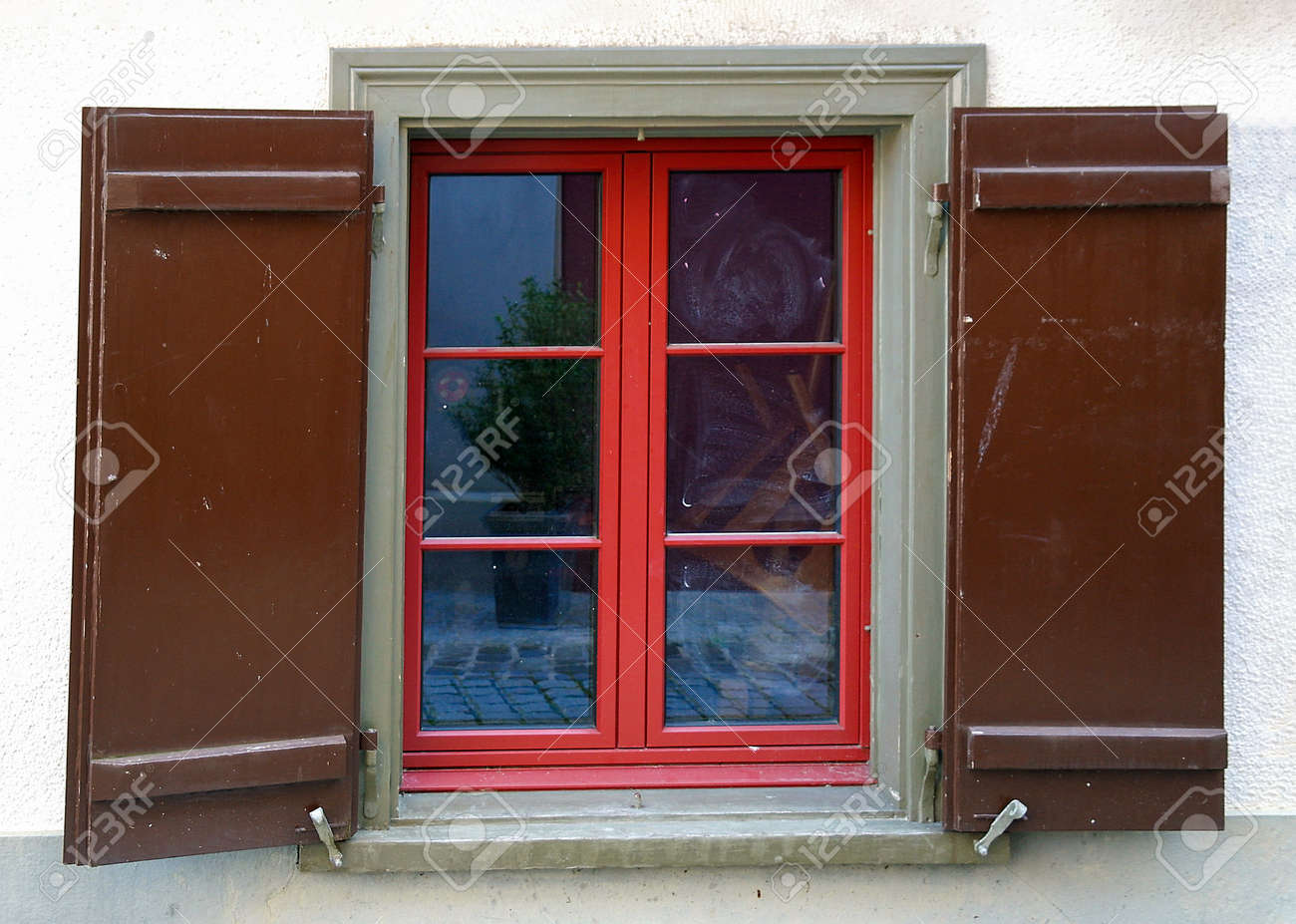 Red And Green Painted Window Frame With Dark Brown Wooden Shutters ...