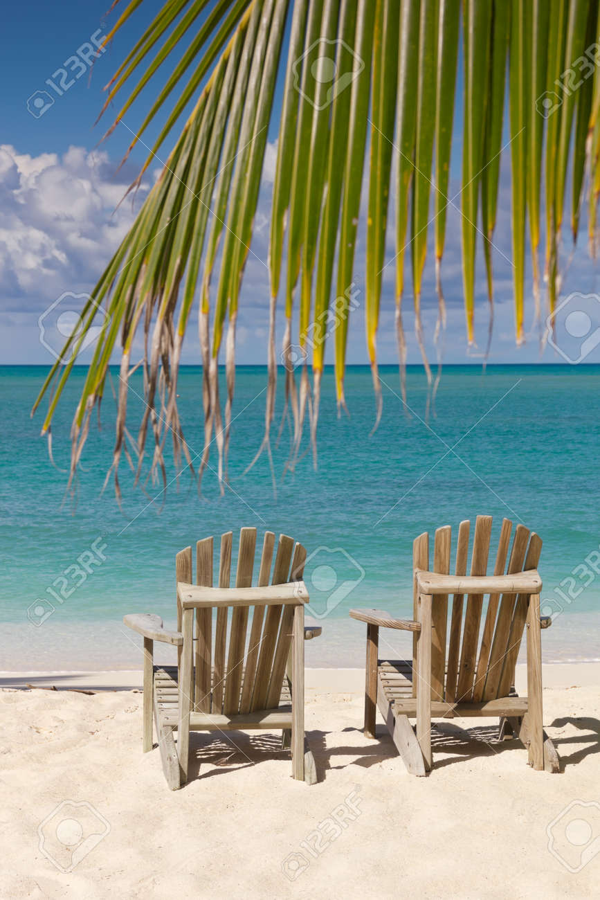 Beach with chairs - Beach Chairs On White Sand Beach With Cloudy Blue Sky And Sun Stock Photo 14750916