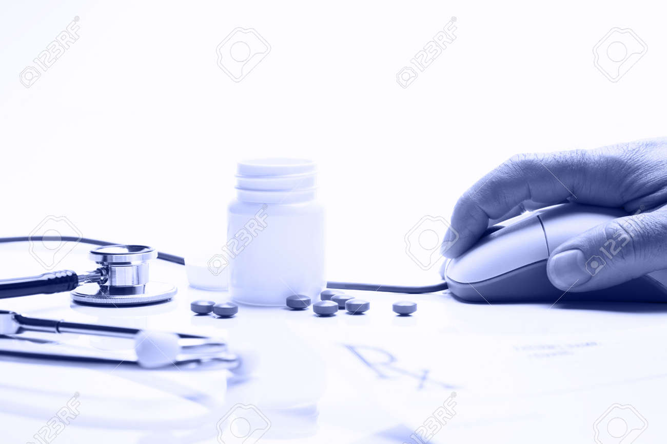 Prescription medicine and pharmacist hand on computer mouse in