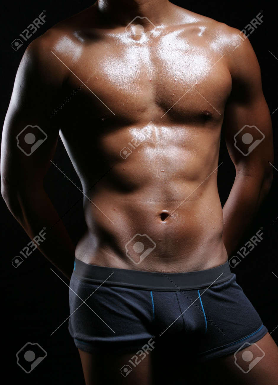 hunky asian young man in boxer trunks and hands behind Stock Photo - 4329436