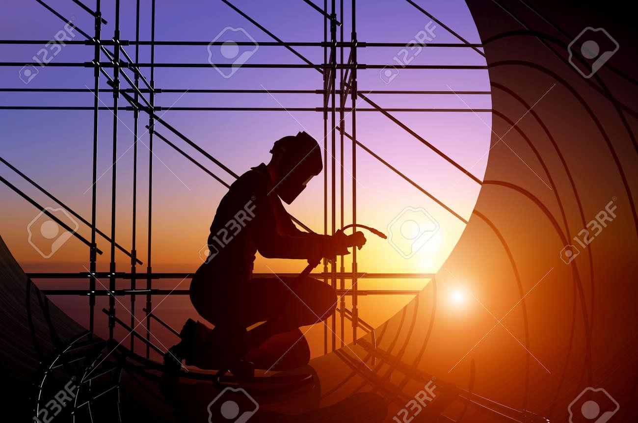 A silhouette of a worker-welder. - 20123328