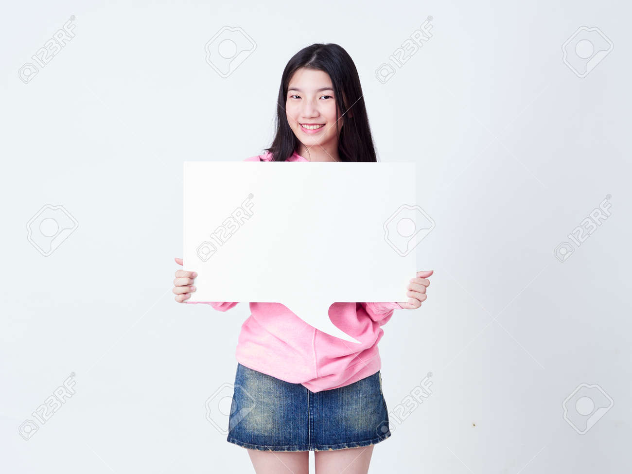 Portrait of teenage girl showing placard empty isolated on white background. - 143662884