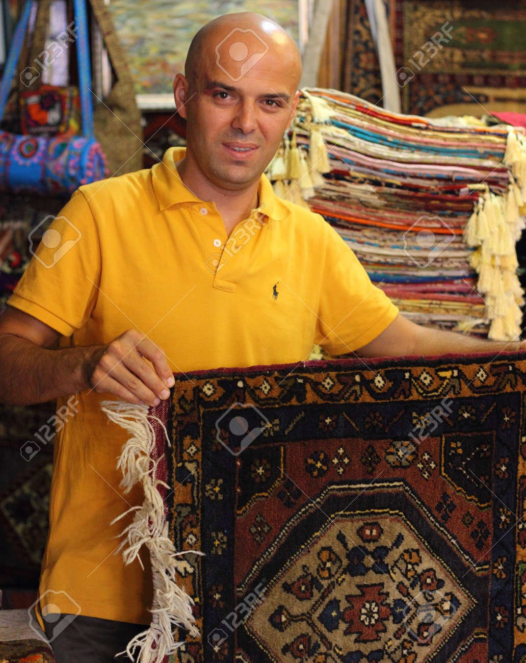 Local Trader With His Textiles ,rugs And Fabrics For Sale In ...