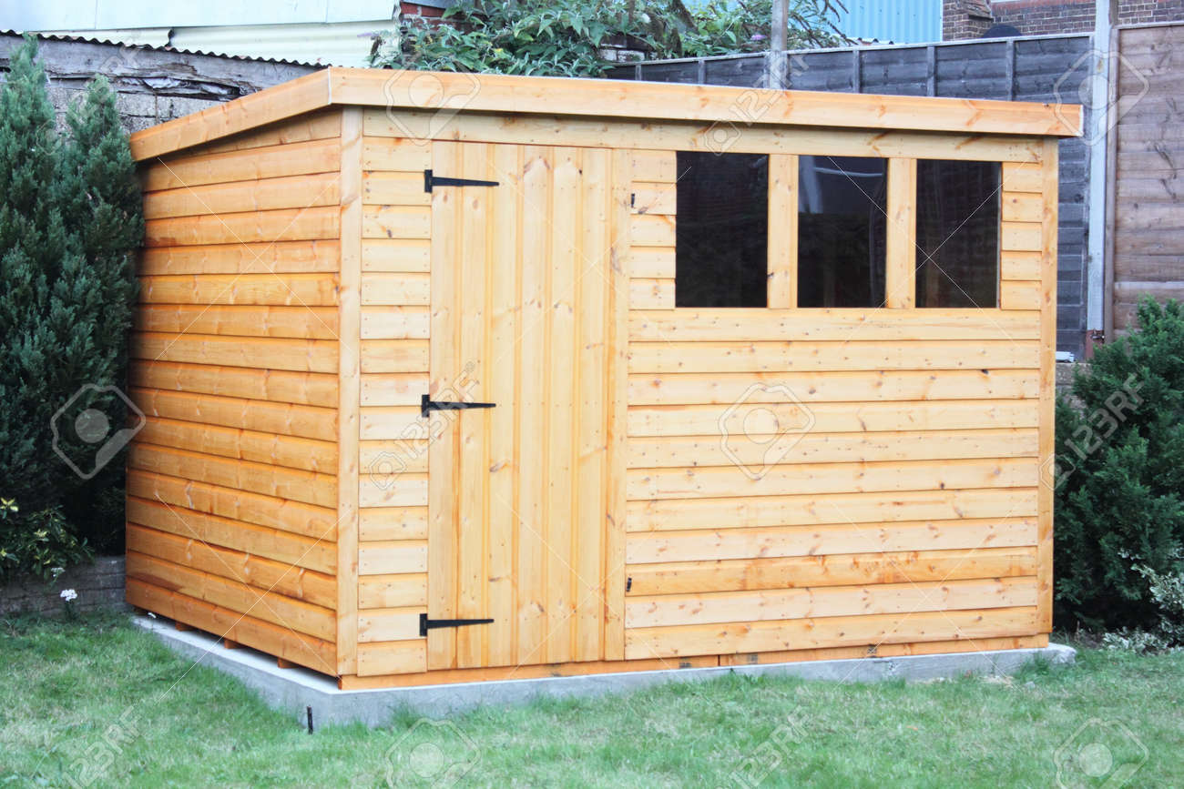 A Newly Built Wooden Garden Shed Sitting On A Concrete Base Stock Photo    22576717