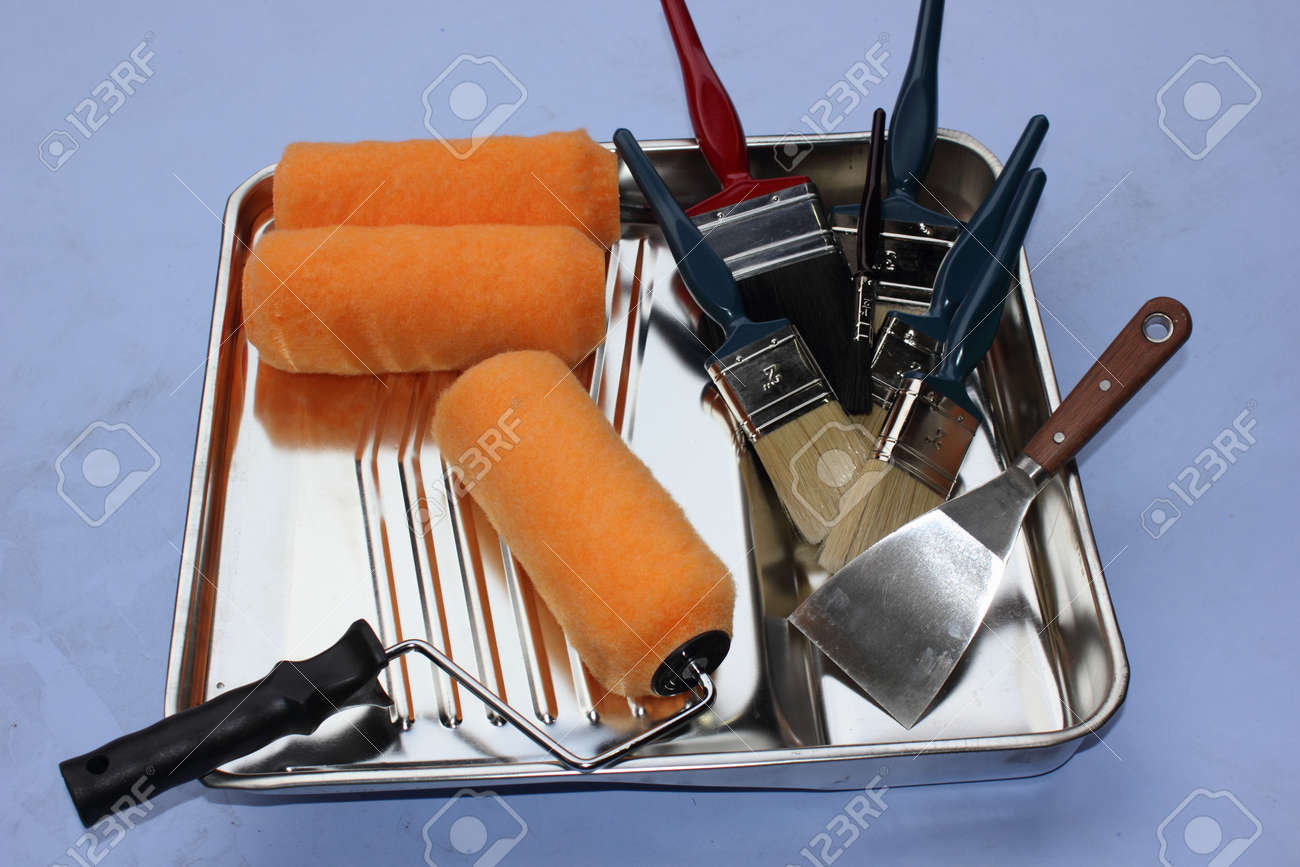 A Decorators Industrial Metal Paint Tray With Rollers Scraper And An Assortment Of Brushes Stock