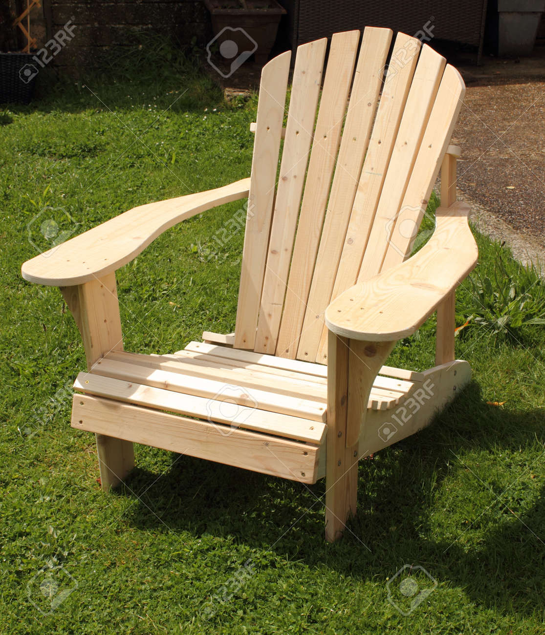 A Handmade Adirondack Chair Made Out Of Old Recycled Wood And Ready For  Painting Stock Photo