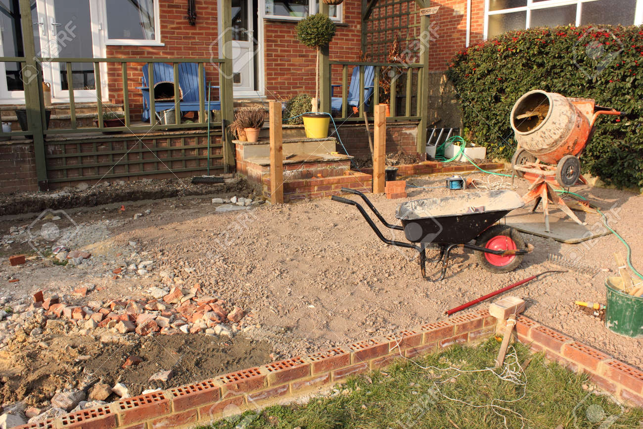 Building A Large Patio In The Back Garden Of An English Bungalow ...