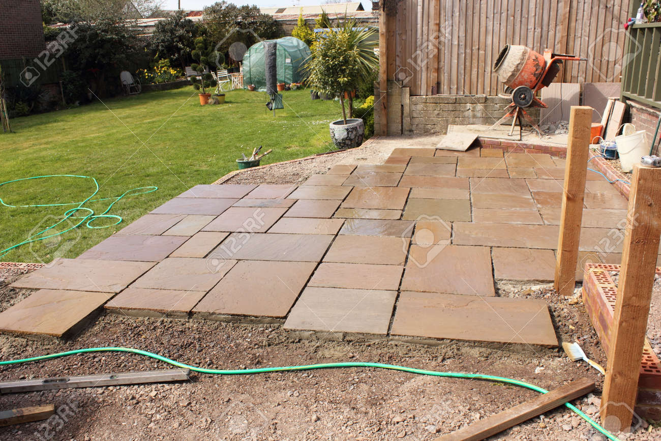 The Construction And Building Of A Natural Stone Patio In An English Garden  Stock Photo