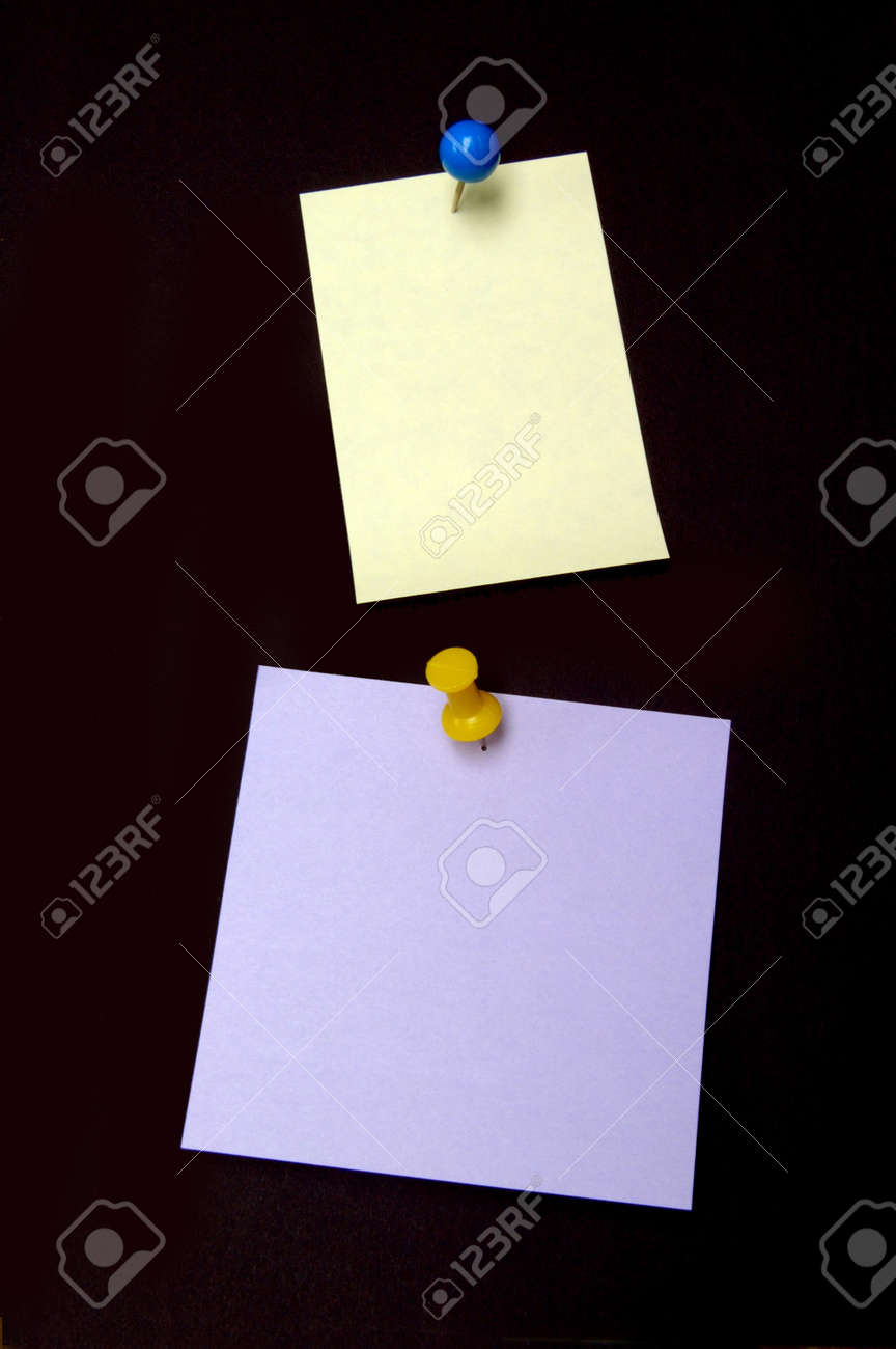 Yellow and purple notes with colored pushpins Stock Photo - 4551618
