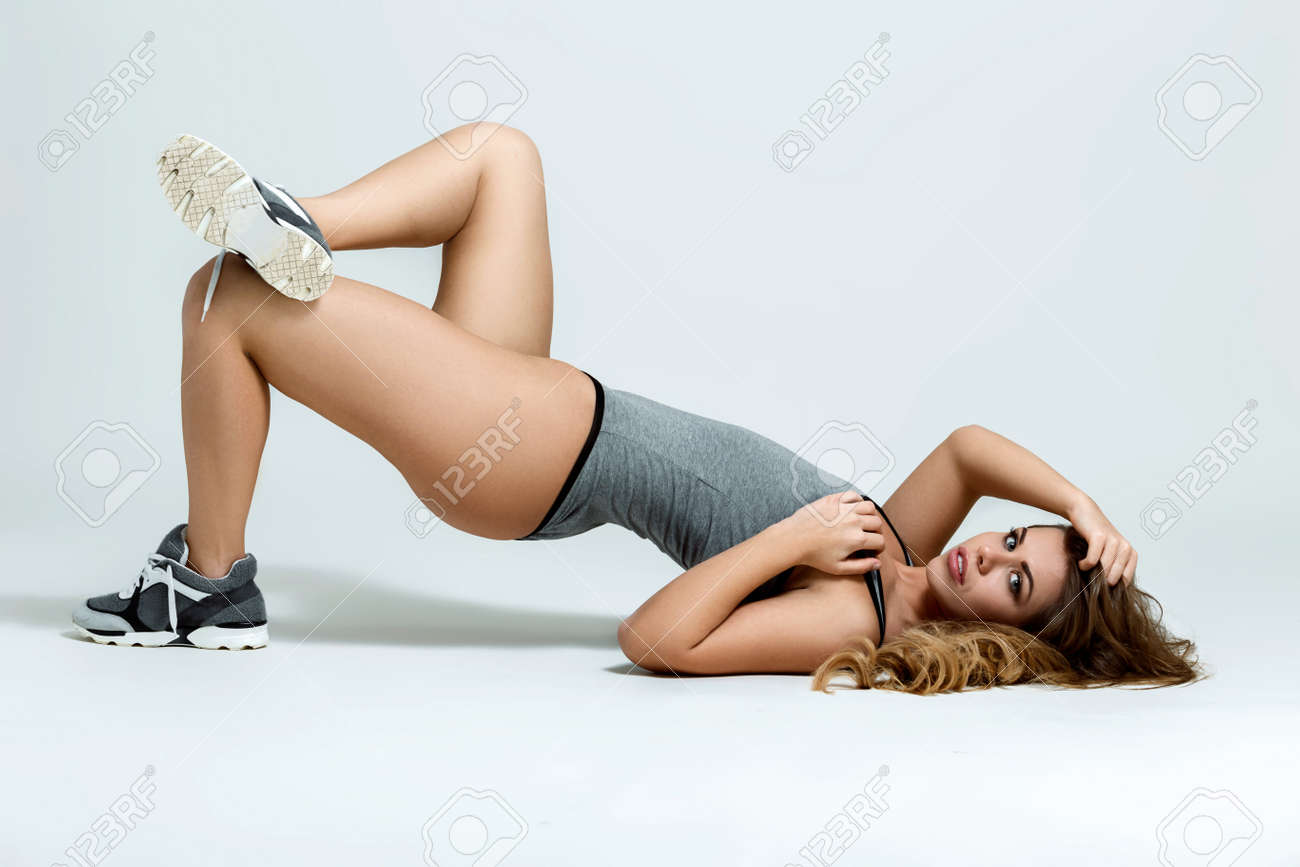 41fa9a95b Stock Photo - Young sexy fit woman in sports outfit
